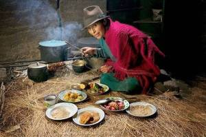 Maria Ermelinda Ayme Sichigalo, a farmer and mother of 8, cooks over a hearth, consumes 3800 kcal/day