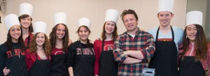 Stanford Dining and Enterprises welcomed Award Winning Chef Jamie Oliver to Stanford's Teaching Kitchen at Arrillaga Family Dining Commons. In toques are student Ameena Tawakol, Hanah Yendler, student outreach coordinator, students Kathleen Howell, Carla Sneider, Rachel Crovello, Maggie Ford, Chef Jamie Oliver, Andrew Beckman, and Jisoo Keel.